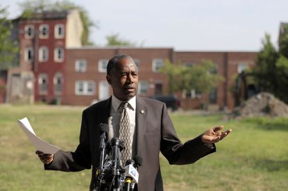 Housing and Urban Development Secretary Ben Carson speaks during a news conference after touring the Hollins House, a high rise building housing seniors and persons with disabilities, during a trip to Baltimore, Wednesday, July 31, 2019. Carson highlighted the Hollins House, which has 130 one-bedroom units, as an opportunity zone where encourage investment and development in distressed communities. (AP Photo/Julio Cortez)
