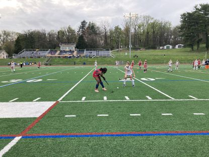 Franklin's Loryn Jordon, left, looks for an opening as Catonsville's Brigid Baeck defends in the Indians' 6-2 victory. Jordon had two goals and an assist for the Indians and Baeck had a goal for Catonsville.