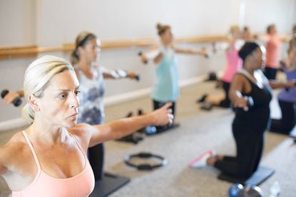 Michelle Mardiney of Lutherville works out during a class at Barre in Pikesville.