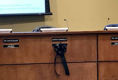 This black ribbon was posted below the name plate of Harford County Board of Education member Kathryn Carmello, who died suddenly on Dec. 23. Her colleagues paid tribute to her during their meeting Monday evening.