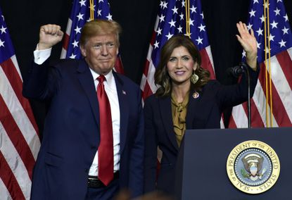 FILE - In this Sept. 7, 2018 file photo President Donald Trump appears with South Dakota Gov. Kristi Noem in Sioux Falls, S.D. Noem catapulted onto a shortlist of conservative politicians favored by Trump with her libertarian approach to the pandemic. With the virus waning, she may be seeking to stay there by picking some legal fights sure to please the right. (AP Photo/Susan Walsh, File)