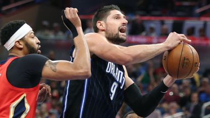 Injured Magic center Nikola Vucevic is having difficulty watching from afar