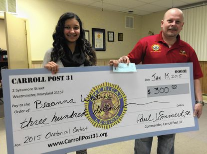Commander Paul Emmert Sr., of Carroll Post 31 of the American Legion, presents Breanna Whitney, a Winters Mill High School sophomore, with a $300 scholarship as a result of her participation in the annual American Legion High School Oratorical Scholarship competition. She will move on to compete in the Carroll County oratorical contest in February.