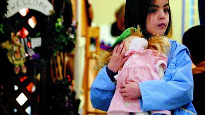 Emily Anderson, of West Friendship, browses through an aisle of holiday crafts with her doll Sally at the annual bazaar at St. James United Methodist Church.