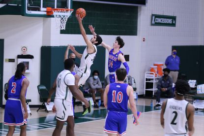 Loyola Maryland's Santi Aldama scores two of his 13 points in front of American's Johnny O'Neil (14) on Wednesday during the Greyhounds' 60-49 win in Reitz Arena.