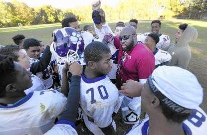 Pikesville head coach Jeff Fuller talks to his team at the end of a high school football practice.