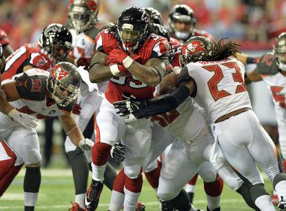 Falcons running back Steven Jackson braces for contact against the Buccaneers during the first half of their Sept. 18 game.