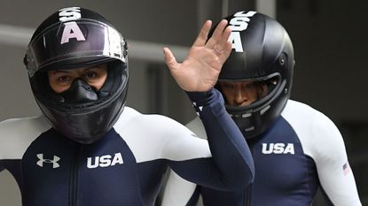 Americans Elana Meyers Taylor, left, and Lauren Gibbs celebrate after their second heat of the women's bobsled. They're 0.07 of a second off the lead entering Wednesday's final two runs.