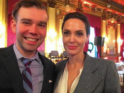 "John Carroll graduate Stephen Douglas poses with Angelina Jolie. Douglas briefly portrays his grandfather, Clarence Douglas, in Jolie's movie, ""Unbroken."""