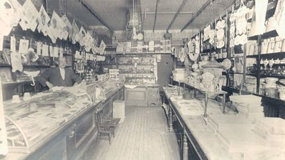 Original caption: Robert M. Roth's stationery store at 636 North Chester street in about 1900. Note the Valentines hanging on the right.