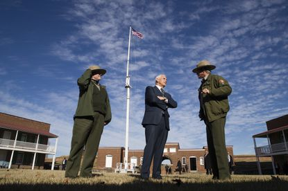 Vice President Mike Pence, center, tours Fort McHenry National Monument and Historic Shrine, Friday, Feb. 8, 2019, in Baltimore.