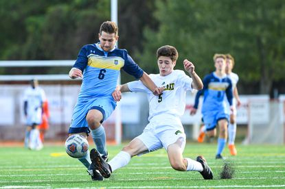 River Hill's Alex Krause and Wilde Lake's Thomas Brinkley battle during the second period at River Hill High School last week. Wilde Lake knocked River Hill from its unbeaten perch.