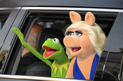 """(FILES) In this March 11, 2014 file photo, Kermit the Frog and Miss Piggy arrive for the world premiere of Disney's """"Muppets Most Wanted,"""" at El Capitan Theatre in Hollywood, California. Miss Piggy and Kermit the Frog shocked Muppets fans August 4, 2015 by announcing the end of their long-running and often tortured love affair. """"After careful thought, thoughtful consideration and considerable squabbling, we have made the difficult decision to terminate our romantic relationship,"""" they said on their respective social media accounts. They will still be working together, not least in a Muppets mockumentary series to premiere on the ABC television network on September 22. AFP PHOTO / ROBYN BECKROBYN BECK/AFP/Getty Images ** OUTS - ELSENT, FPG - OUTS * NM, PH, VA if sourced by CT, LA or MoD **"""