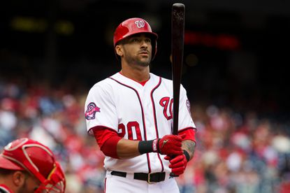 Washington Nationals' Ian Desmond (20) looks at his bat before hitting a home run in the second inning of a baseball game against the Philadelphia Phillies at Nationals Park, in Washington, on Sunday, Sept. 27, 2015. (AP Photo/Jacquelyn Martin)