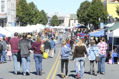A crowd walks up and down Washington Street in Havre de Grace during Graw Days Saturday.