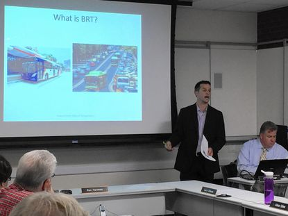 Transportation Planner Chris Eatough of the Howard County Office of Transportation explains how bus rapid transit systems operate in conjunction with traffic during the Public Transportation Board meeting Tuesday night in Ellicott City.