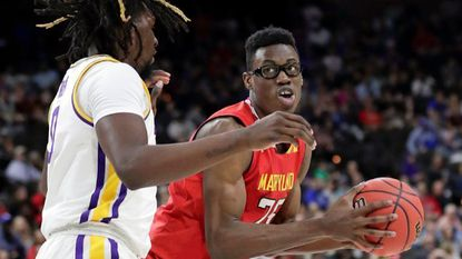 Maryland's Jalen Smith, right, looks for a shot against LSU's Naz Reid during the first half of a second-round game in the NCAA men's college basketball tournament in Jacksonville, Fla., Saturday, March 23, 2019.