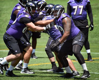 Ravens 2016 first round draft pick Ronnie Stanley, right, practice against Anthony Fabiano during OTA at Under Armour Performance Center.