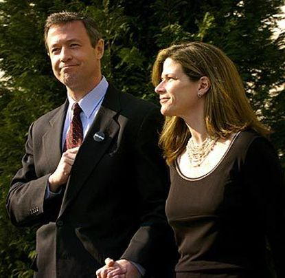 Baltimore Mayor Martin O'Malley and his wife, Catherine, today walk outside City Hall, where the couple denounced rumors of infidelity spread by an aide to Gov. Robert L. Ehrlich Jr.