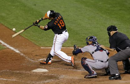 Orioles' Gerardo Parra (18) hits a three-run home run in front of Minnesota Twins catcher Kurt Suzuki and home plate umpire Eric Cooper during the sixth inning, Friday, Aug. 21, 2015, in Baltimore.