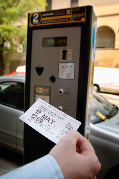Towson leaders and businesses have worked to create new signage to diminish confusion over private and county parking lots in downtown Towson. Parking receipts, shown here and which are to be displayed on a car's dashboard, must be purchased at a parking vending machine station. But there was been confusion over where to pay for each of the lots.