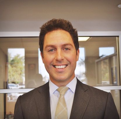 Evan Berney is CEO of CarBiz, a used car dealership on Reisterstown Road.