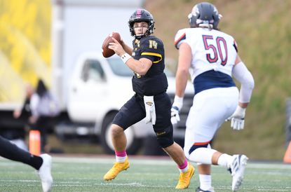Towson quarterback Tom Flacco looks to pass during a game against Bucknell on Saturday, Oct. 19, 2019.