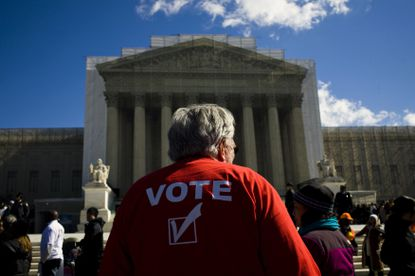 People gather outside the Supreme Court in Washington on Feb. 27, 2013, to await the ruling in Shelby County v. Holder. The opinion struck at the heart of the Voting Rights Act of 1965.