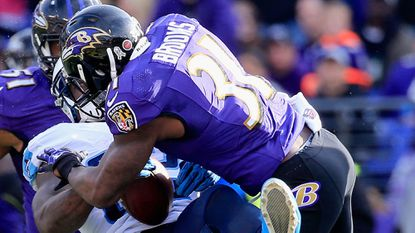 Tebbessee Titans tight end Delanie Walker takes a second quarter hit from Ravens free safety Terrence Brooks.