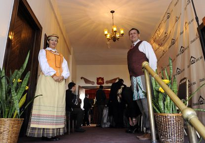 Baltimore, MD-- January 10, 2015--Alina Malisauskas, left, and her husband Audrys, right, greet visitors at the historic Lithuanian Hall , which held its 100th anniversary celebration this afternoon. Barbara Haddock Taylor/Baltimore Sun