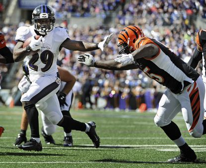Ravens running back Justin Forsett stiff-arms the Bengals' Wallace Gilberry during his touchdown run in the third quarter of their early-September meeting.