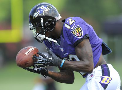 Ravens wide receiver Jacoby Jones catches a punt during training camp in Owings Mills.