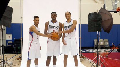 The Los Angeles Clippers' new 2016 NBA basketball draft picks, from left, David Michineau, Diamond Stone, and Brice Johnson pose for photos in Los Angeles on July 12, 2016.