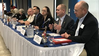 Sen. Jason Gallion, second from right, discusses the most recent session of the Maryland General Assembly during a Harford County Chamber of Commerce breakfast Thursday at Harford Community College.