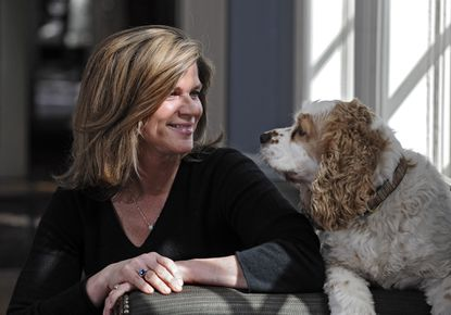 Maryland First Lady Katie O'Malley poses for a photograph with the family dog, Rex.