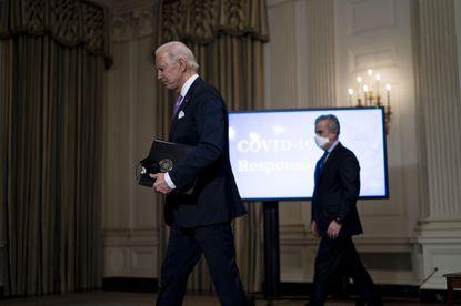 President Joe Biden and Jeff Zients, the COVID-19 response coordinator, depart an event where Biden spoke about the fight to contain the COVID-19 pandemic, at the White House in Washington on Tuesday, Jan. 26, 2021.