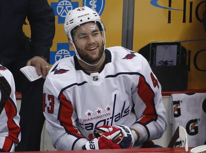 Washington Capitals' Tom Wilson sits on the bench after colliding with with Pittsburgh Penguins' Zach Aston-Reese (46) during the second period in Game 3 ofa second-round hockey playoff series in Pittsburgh, Tuesday, May 1, 2018. Aston-Reese suffered a broken jaw and will miss the rest of the playoffs.