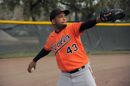 Baltimore Orioles pitcher Odrisamer Despaigne (43) warms up for his bullpen session during spring training practice at the Ed Smith Stadium complex.