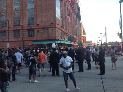 Protesters block traffic on East Pratt Street in downtown Baltimore Saturday