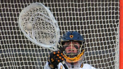 One of the top priorities for UMBC men's lacrosse is finding a goalkeeper to replace Ruston Souder, shown stopping a shot against Johns Hopkins in a game on March 30, 2016.