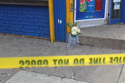 Flowers were placed at the entrance of Kim Deli & Grocery after Carmen Rodriguez, 36, was shot and killed inside the store Sunday, Dec. 22, 2019.