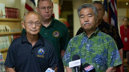 Hawaii Emergency Management Agency Administrator Vern Miyagi, left, and Gov. David Ige address the media Saturday at the HEMA center at Diamond Head Crater.