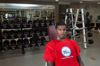 Allan Chaney poses in the Virginia Tech weight room during June as he was preparing for his return to the court.