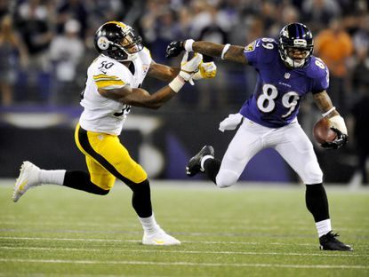 Ravens wide receiver Steve Smith tries to shake off Steelers linebacker Ryan Shazier after catching a pass from quarterback Joe Flaco in the second quarter of their Sept. 11 meeting earlier this season at M&T Bank Stadium.