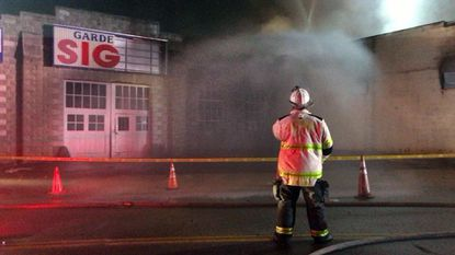 Firefighters investigating blaze at Northeast Baltimore car shop