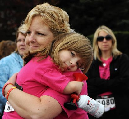 Lisa Gardner of Reisterstown holds her daughter, Elizabeth Gardner, 8. Elizabeth holds an air horn that she will use to start the 15-Mile Ride and 6-Mile Family Ride at the 8th Annual Save-A-Limb Ride, Walk, and Festival benefitting Sinai Hospital. She is the event's honorary patient from Baltimore County.