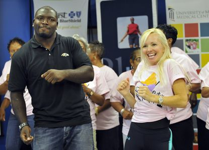 Vonta Leach (left) dances as part of an event at the Zeta Center for Healthy and Active Aging in Baltimore last month. The Ravens fullback has been generous with his time, his money and his blocking dating back to his time with the Houston Texans.