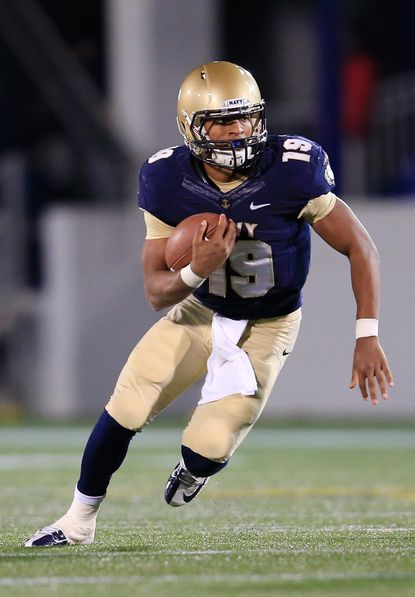Navy quarterback Keenan Reynolds rushes the ball against the Hawaii Warriors during the third quarter of Navy's 42-28 win at NavyMarine Corps Memorial Stadium on Nov. 9, 2013.