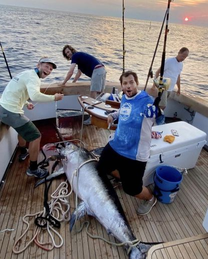 Annapolis resident Peter Schultz (far left) and crew fishing in the Huk Big Fish Classic last weekend in Ocean City, MD, landed this 301-pound swordfish that has been certified as the first Maryland state record. They fished aboard Real One, and won more than $500,000 in prize money. (Photo courtesy of Huk Big Fish Classic.)