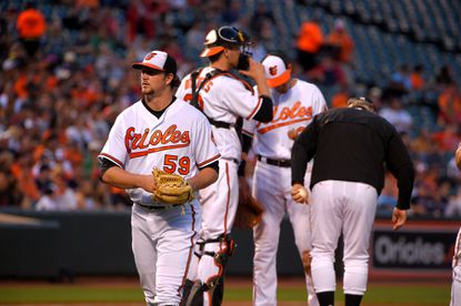 Orioles starting pitcher Mike Wright (58) is removed by manager Buck Showalter, after not being able to make it through three innings against the Boston Red Sox at Oriole Park at Camden Yards on June 1, 2016.